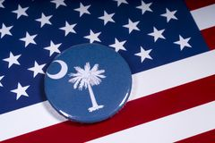 The State of South Carolina. London, UK - November 15th 2018: The symbol of the State of South Carolina, pictured over the flag of the United States of America royalty free stock images