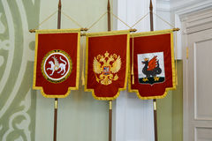 State symbols of Russia and the Republic Tatarstan. The Russian state emblem - the double-headed eagle, the Emblem of the Republic of Tatarstan - Snow winged Stock Photography
