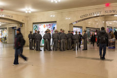 State Troopers and MTA K-9 unit at  Grand Central Terminal. NEW YORK CITY - JANUARY 10, 2015: New York State Troopers and MTA K-9 unit meet at Grand Central Royalty Free Stock Images