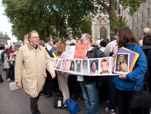 State Visit of the Pope. Protesters holding photographs and placards wait outside Westminster Abbey, London, for the Pope's arrival, September 17 2010 Royalty Free Stock Photography