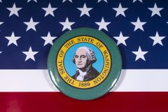 The State of Washington. London, UK - November 15th 2018: A badge portraying the seal of the State of Washington, pictured over the flag of the United States of royalty free stock image