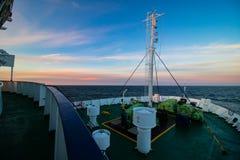 Statek na oceanie przy zmierzchem Obrazy Royalty Free