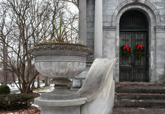 Stately Crypt. A stately crypt in an old cemetary in winter stock image