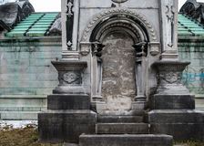 Stately Crypt. A stately crypt in an old cemetary in winter royalty free stock photo