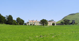 Stately home. The exterior of a Stately Home with a green field in the foreground royalty free stock images
