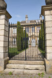 Stately Home. Gate and Garden Path of a Stately Manor House Stock Photography