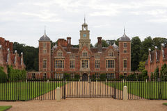 Stately home. Grand English stately home set in enclosed grounds royalty free stock image