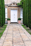 Stately Home and Garden. Tree Lined Garden Path Leading to a Stately Home royalty free stock images