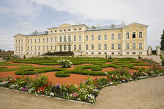 Stately Home In Latvia. Stately home with a beautiful landscaped ornamental garden in Latvia stock photo