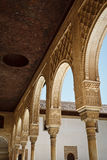 Stately, intricately carved, moorish arches. Stately, white, intricately carved, moorish arches of covered walkway in courtyard royalty free stock photos