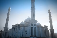 Stately mosque on the winter sky background.  stock photography