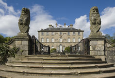 Stately Scottish house. View of the rear of Pollok House, Pollok Park, Glasgow, Scotland, showing the steps, sculptured gate-posts and gates that serve as an Stock Photo