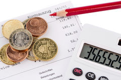Statement of account and coins Stock Photo