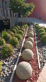 Statement Design. Landscape Using coloured stone and concrete balls stock image