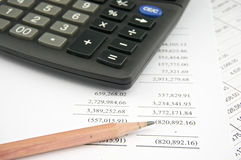 Statements of income with pencil and black calculator Stock Images