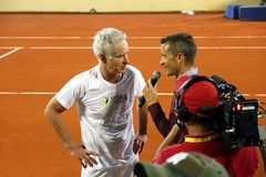 Journalist interviewing John McEnroe after a tennis match. Statements to the press of McEnroe after a tennis match of senior category Royalty Free Stock Photo