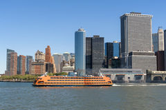 Staten Island Ferry departing from NYC's Lower Manhattan on a cl Royalty Free Stock Image