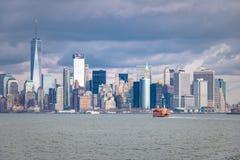 Staten Island Ferry and Lower Manhattan Skyline - New York, USA. Staten Island Ferry and Lower Manhattan Skyline in New York, USA Stock Images