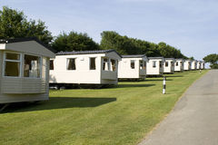 Static caravans on a camping site. Static caravans in a camping site on a sunny day Royalty Free Stock Photo