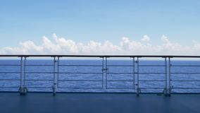 Static Establishing Shot Looking Over Cruise Ship Railing at Ocean. 8896 A static daytime establishing shot looking at the open ocean from the deck of a cruise stock footage