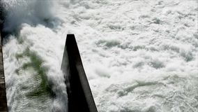Static medium high angle shot of swirling water waves coming from the irrigation dam spillway. Alfonso Lista, Ifugao, Philippines - July 18, 2017:  Static medium stock video footage