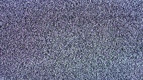 Static noise of flickering detuned TV screen. Close up shot stock video footage