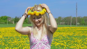 Static shot of blond lady and dandelion field. stock video