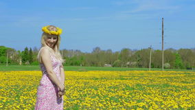 Static shot of blond lady and dandelion field. stock video footage