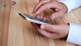 App browsing, text messaging on mobile phone. Using smartphone. Static Shot. stock footage