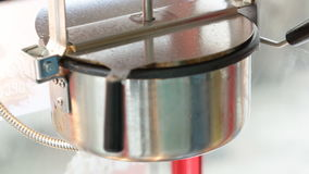 A static shot of a commercial popcorn machine. stock footage