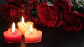 Heart-shaped candles and roses. Static shot of Valentines Day items in hd stock footage