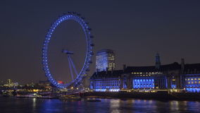 Static, time-lapse of the London Eye from across the river Thames stock video