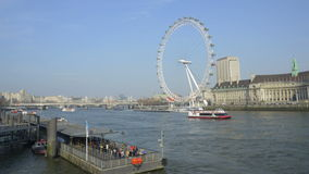 Static, time-lapse of the London Eye from across the Thames stock video footage