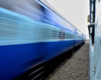 Static Train vs. Super Fast Train - Indian Railways. A super fast express train - speeding past the static train halted on the other platform stock images