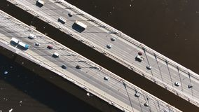 Static view from above a cable-stayed bridge, aerial shooting over traffic from cars. Above the river stock video footage