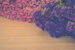 Statice flowers on wooden,Vintage tone Royalty Free Stock Image
