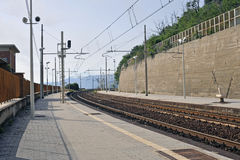Station. Sunny railway platform passing in a countryside station Royalty Free Stock Photography