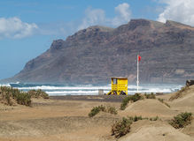 Station of beach patrol, Famara. A new station beach guard with red flag Royalty Free Stock Image