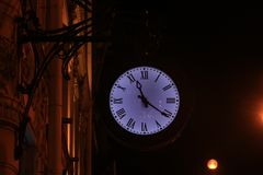 Station clock. In the evening Stock Image