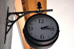 Station clock hanging Stock Photo