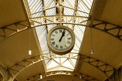 Station clocks hang on the ceiling of the old station. stock photo