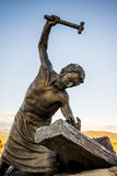 Station of the Cross Landmark Colorado. Historic landmark located in San Luis Colorado, near the New Mexico Border. Statue of man raising hammer used to nail Royalty Free Stock Photo