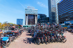 Station forecourt of the main station in The Hague, Netherlands. The Hague, Netherlands - April 21, 2016: forecourt of the main station with unidentified people Royalty Free Stock Photos