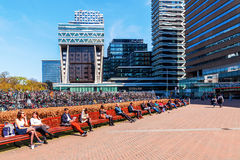 Station forecourt of the main station in The Hague, Netherlands. The Hague, Netherlands - April 21, 2016: forecourt of the main station with unidentified people Stock Images