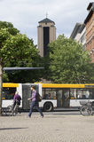Station forecourt Mainz. Mainz, Germany - June 5, 2014: The station forecourt with pedestrians, a passing bus and the tower of St. Boniface monastery on June 05 Stock Photography