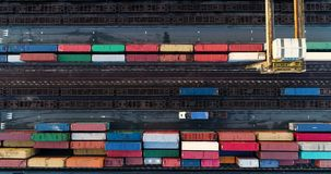 Station with freight trains and containers. In aerial view stock video