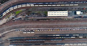 Station with freight trains and containers. In aerial view stock footage