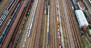 Station with freight trains and containers stock footage
