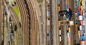 Station with freight trains and containers. In aerial view stock video footage