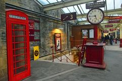 Station furniture at Bury Bolton Street Station. Old fashioned signage, clock and memorabillia at Bury Bolton Street Station on the east lancs railway The East royalty free stock photo